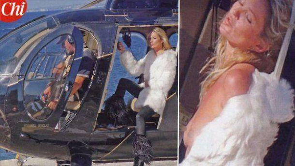 Kate Moss in topless e pelliccia a Ischia