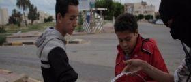 ISIS festeggia Parigi : Caramelle in strada in Libia